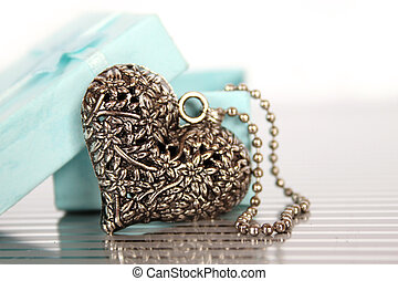 Heart Necklace - Close-up of a heart necklace in a gift box
