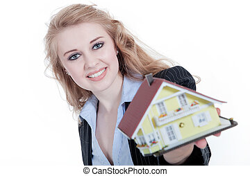 Real estate agent with miniature house