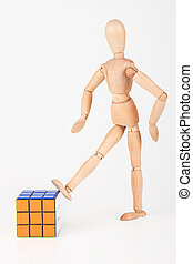 Disgusted wood mannequin kick cube puzzle confused after solving it