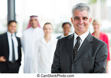 happy mature businessman looking at the camera