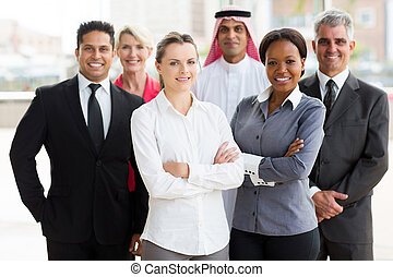 multiracial business team in office - portrait of smiling...