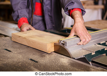 Hands carpenter working with a circular saw - Hands...
