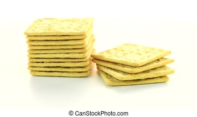 Cracker cookies cracker rotate on a white background.