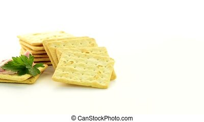 Cracker cookies appetizer rotate on a white background