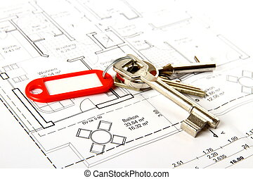 Bunch of keys with red keychains at building drawing, close...