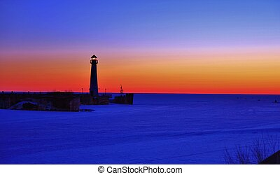 St Ignace Sunrise - The Wawatam Lighthouse is located in St...