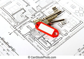 Bunch of keys with red keychains at building drawing, soft...