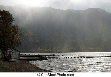 Rain moving in - Beach shot of rain moving at Cultus Lake in...