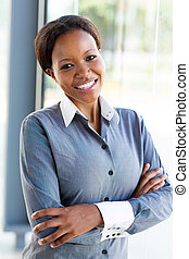 african businesswoman with arms folded