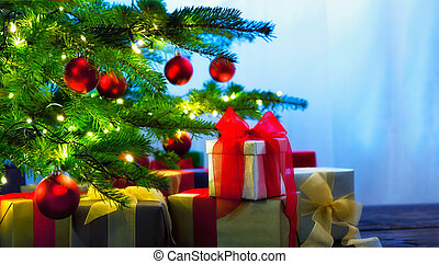 Christmas tree decorated with presents in living room