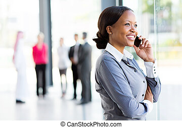 african corporate worker talking on mobile phone - beautiful...