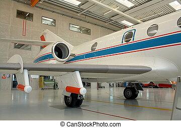 Business aircraft in a aircraft hangar - Business aircraft...