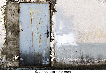 Ruined brick wall closed steel door - Ruined brick wall with...