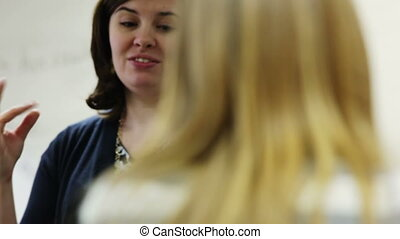 teacher student discussion - A high school teacher having a...