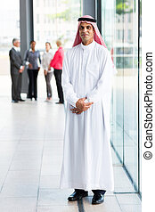 middle eastern businessman in modern office
