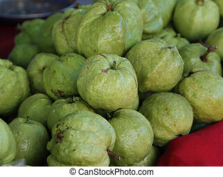 guavas in the market - green guavas in the market
