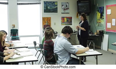 teacher giving a lecture - A high school teacher giving a...