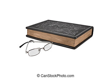 Glasses are lying next to the book
