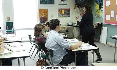 Teacher giving lecture - A high school teacher giving a...