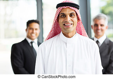 muslim businessman with team on background - happy muslim...