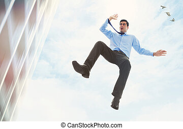 Crisis - Stock image of businessman falling off a building