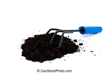 Rake with potting compost - A gardening rake with potting...