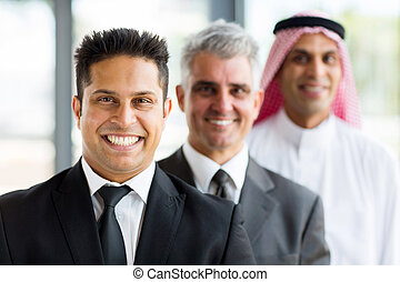 three businessmen standing in a row