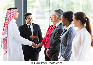 young translator introducing Arabian businessman to business...