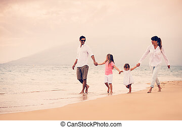 Happy Family have Fun Walking on Beach at Sunset - Happy...