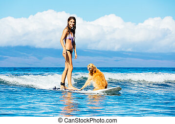Young Woman Surfing with Her Dog - Attractive Young Woman...