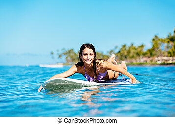 Young Woman Surfing in Hawaii, Paddling out to the Lineup -...