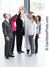 business team giving high five in office - happy business...