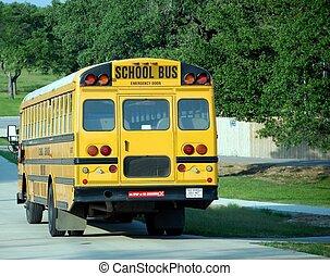 School Bus - Yellow school bus on a leafy suburban street