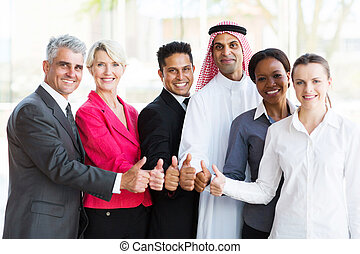 multiracial business team giving thumbs up - group of...