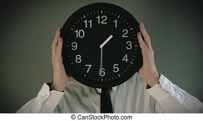 Businessman with clock face - Wasting time. Businessman with...