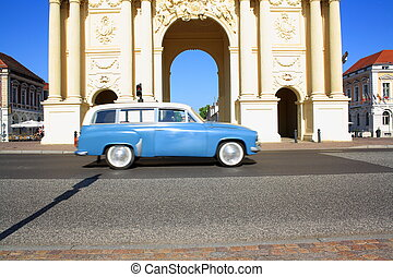 Brandenburg Gate in Potsdam and retro car, horizontal