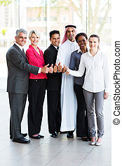 business group giving thumbs up - cheerful business group...
