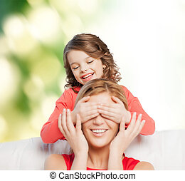 smiling mother and daughter making a joke - family, child...