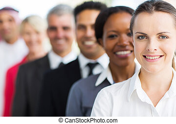 businesswoman with colleagues standing in a row