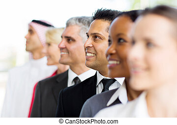 indian businessman standing in a row with co-workers