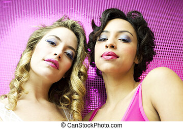 two beautiful sexy disco women in a bar lounge with...