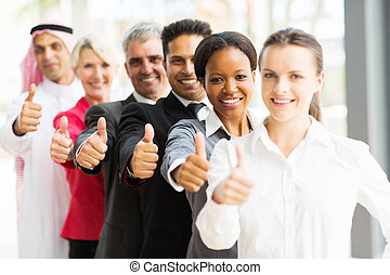 business team in a row giving thumbs up - portrait of...