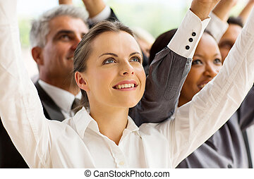 young businesswoman arms up - beautiful young businesswoman...