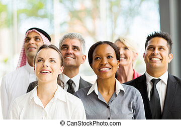 multicultural business group looking up - cheerful...