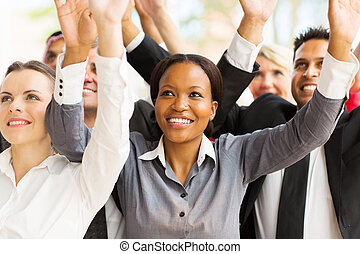 business team with arms up - successful business team with...