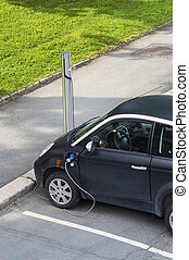 Electric car plugged in to electricity - Free Recharging...