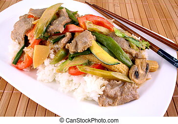 Beef with Asian vegetables, rice, mushrooms and peanut sauce...