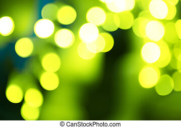 Holiday abstract green and yellow lights can be used for...