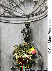 Manneken Pis statue in the centre of Brussels. - The famous...