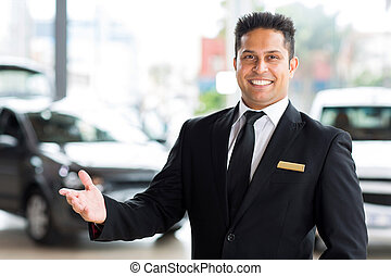 young indian car dealer - happy young indian car dealer...